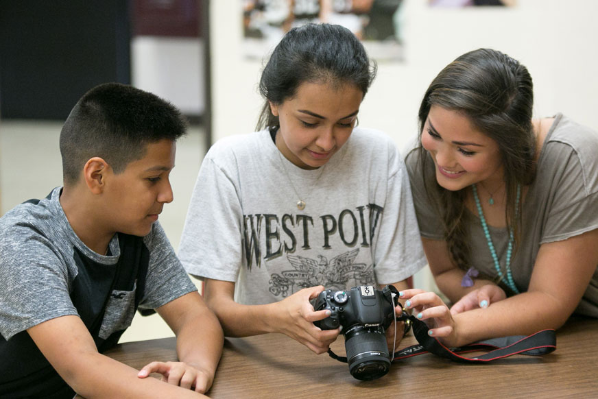 students with digital camera