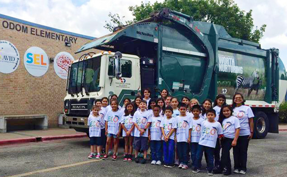 Odom Elementary Students standing by recycling truck outside of school