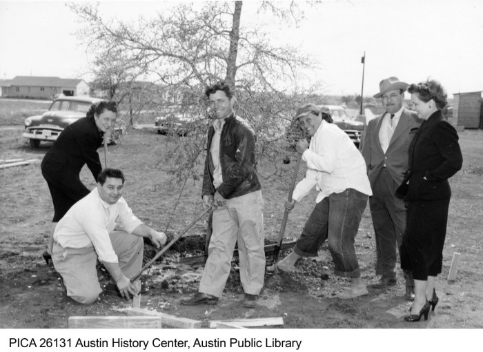 Photograph of a group of 3 women and 3 men posing next to a tree that had just been planted at Brentwood Elementary School.